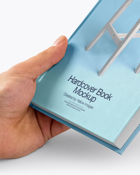 Hardcover Book In A Hand Mockup In Stationery Mockups On Yellow