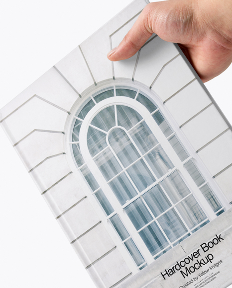 Hardcover Book in a Hand Mockup