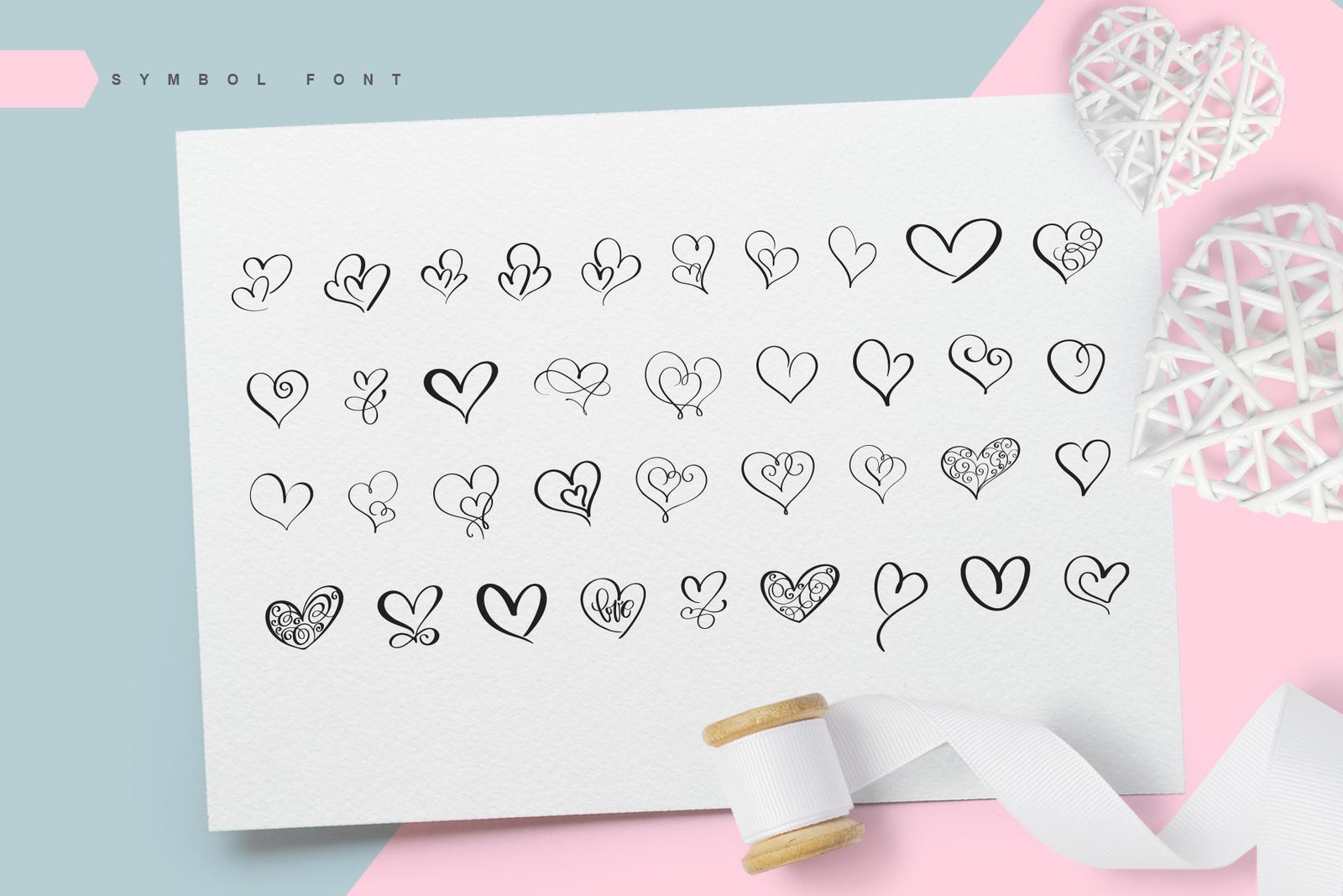 Lovingly Symbol Flourish Hearts Font